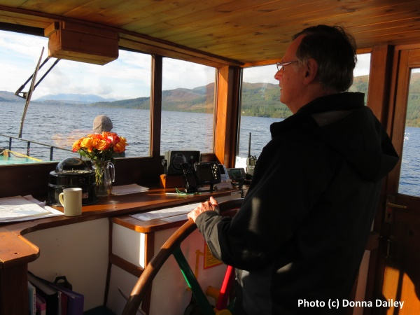 Mike Gerrard attempts to steer Fingal the Barge through Loch Ness on a cruise along the Caledonian Canal in the Highlands of Scotland