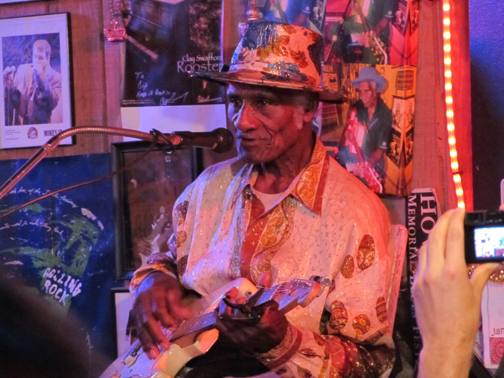 Gip Gipson playing his guitar at Gip's Place near Birmingham in Alabama, one of the last juke joints in the USA